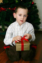 Opening Christmas presents Royalty Free Stock Images