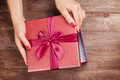 Opening christmas or valentines day gift Royalty Free Stock Photo