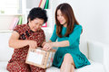 Opening courier parcel asian senior women and daughter a Royalty Free Stock Photography