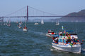 Opening day on the bay golden gate bridge a image showing a parade of boats with in background taken during Royalty Free Stock Image