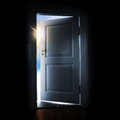 Opening door with shining light and sky outside blue in a dark room Royalty Free Stock Photography