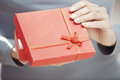 Opening gift hands of woman red box Stock Images
