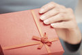 Opening gift hands of woman red box Royalty Free Stock Images