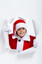 Opening the holidays season boy looking through jagged edge ho hole in white paper layer Royalty Free Stock Photography