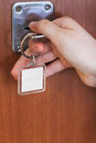 Opening house door by key with blank keychain Royalty Free Stock Photo