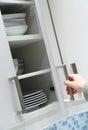 Opening kitchen cabinet door Royalty Free Stock Photo