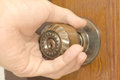 Opening an old door knob Royalty Free Stock Photo