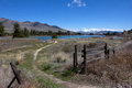 An opening and path to the river this image shows angler s access site flathead with snowy mission mountains of montana in Royalty Free Stock Images