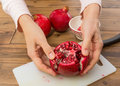 Opening a pomegranate Royalty Free Stock Images
