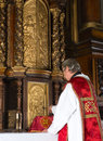 Opening the tabernacle priest th century in a medieval church with baroque interior Stock Images