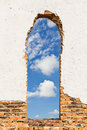Opening on the wall old brick lead to outside blue sky with clipping path Royalty Free Stock Photos