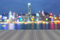 Opening wooden floor, City night lights view, blurred bokeh Royalty Free Stock Photo