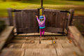 Opening the wooden gates young girl in garden Stock Image