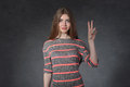 Openness, friendship concept. Woman showing victory sign