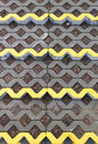 Openwork concrete structure with yellow stripes Royalty Free Stock Photos