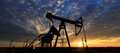 Operating oil and gas well profiled on sky in remote area in europe Stock Photo