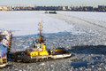 Operation of the auxiliary ships in seaport of st petersburg during winter navigation russia Royalty Free Stock Photos