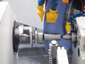 Operator grinding mold and die part Royalty Free Stock Photo