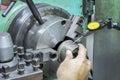 Operator setup turning part on manual lathe machine by dial gauge Stock Photos
