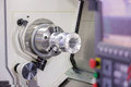 Operator turning aluminium autopart by cnc lathe in industrial factory Stock Photo