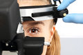 Ophthalmologist binocular sight glass ophthalmoscope examines the eyes using a ophthalmic device Royalty Free Stock Photo