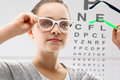 Ophthalmologist a child on the study eye portrait of girl at an Royalty Free Stock Photography