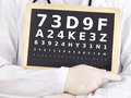 Ophthalmologist holding blackboard with eyesight test an Royalty Free Stock Images