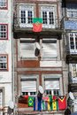 Oporto, Portugal Typical Colorful Portuguese Architecture: Tile Azulejos Facade with Flags, Antique Windows And Balcony - Portugal Royalty Free Stock Photo