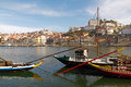 Oporto ribeira colorful in a beautiful spring day seeing the douro river and traditional rabelo boats Royalty Free Stock Images