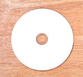 Optical disk on a wooden background Royalty Free Stock Photography