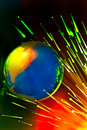 Optical fibers lights speeding on color background Stock Photo