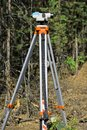 Optical level on a tripod in the field Royalty Free Stock Photo