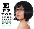 Optician. Beautiful brunette wearing glasses and Snellen eye exam chart isolated on white Royalty Free Stock Photo