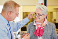 Optician offering consultation to senior women for new glasses Stock Images