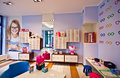 Optician s shop for children interior of salon designed specially to prescribe spectacles with a big choice of frames on the walls Royalty Free Stock Photos