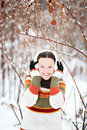Optimistic girl cheerful in winter forest Royalty Free Stock Photo