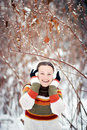 Optimistic girl cheerful in winter forest Royalty Free Stock Image
