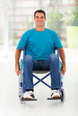 Optimistic handicapped man sitting wheelchair Royalty Free Stock Photography