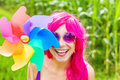 Optimistic young woman wearing pink wig Royalty Free Stock Photo