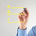 Options different businessman writing with yellow marker pen on the screen Stock Photo