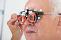 An Optometrist Checking Patient Vision With Trial Frame Royalty Free Stock Photo