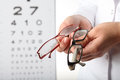 Optometrist with glasses Royalty Free Stock Image