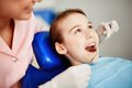 Oral inspection pretty child with open mouth during checkup Stock Photo