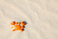 Orane toy crab in sand Royalty Free Stock Photo