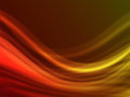 Orange abstract background wave on dark Stock Image
