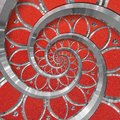 red abstract round spiral background pattern fractal. Silver metal spiral red decorative ornament element. Metal texture Royalty Free Stock Photo