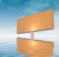 Orange advertisement board stuck in water Royalty Free Stock Photos