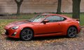 Orange agressive sport car outdoors Royalty Free Stock Photo