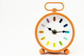 Orange alarm clock on a white background Stock Photo