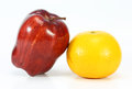 Orange and apple on white background Stock Image